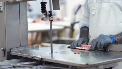 Meat Processing Plant, Butcher Cuts Pork Carcasses, Meat Production and Food Industry, the Process