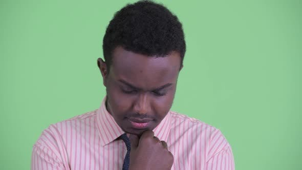Thumbnail for Face of Serious Young African Businessman Thinking and Looking Down