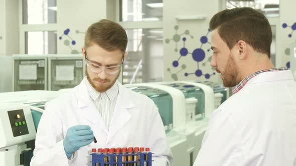 Thumbnail for Colleagues in the Laboratory Discuss the Results of Their Activities
