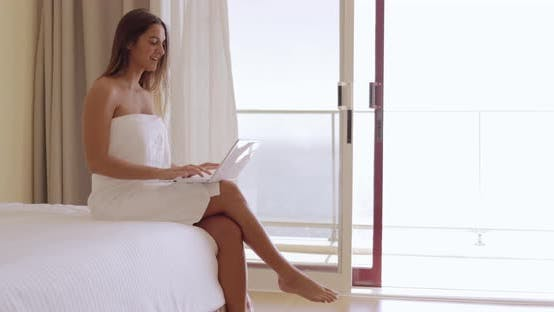 Thumbnail for Girl Relaxing with Laptop in Hotel