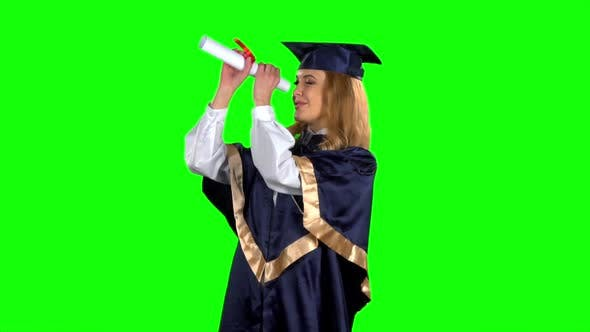 Thumbnail for Woman Graduate in Gown with Diploma. Green Screen. Slow Motion