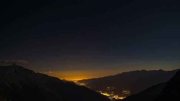 Thumbnail for Time Lapse of the Milky way and the stars in summer night sky rotating over the Alps