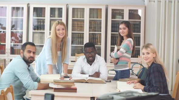 Thumbnail for Group of Multiracial People Studying with Books in College Library.
