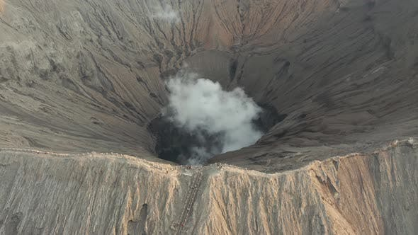 Thumbnail for Aerial drone view of the crater rim of an active volcano