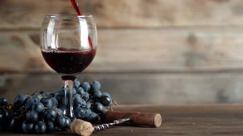 Red Wine Is Poured Into the Glass.