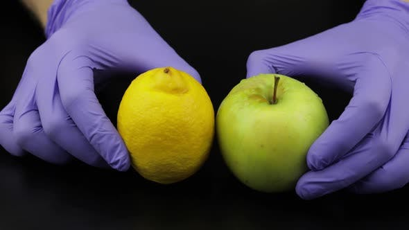 Thumbnail for Doctor Hand Takes Away Syringe, Ampoule. Put Fruits Apple, Lemon. Vitamin Cure
