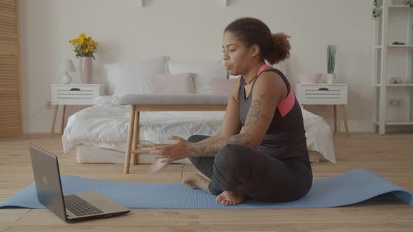 Fit Woman Consulting with Fitness Trainer Online
