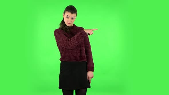 Thumbnail for Woman Talking and Pointing Side Fingers for Something, with Copy Space. Green Screen
