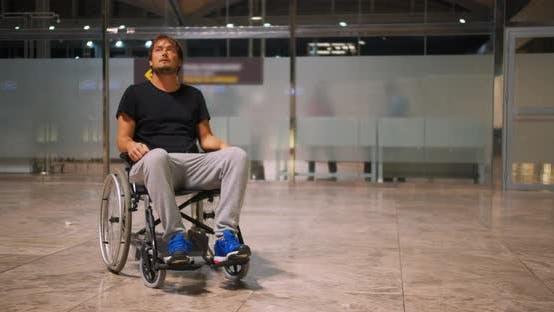 Thumbnail for Disabled Young Man in Wheelchair on an Airport.
