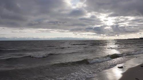Sea Coast Waves on the Sandy Beach Sunset on the Sea Cloudy Weather