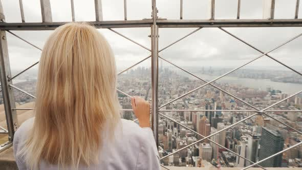 Thumbnail for Rear View of a Woman Admiring New York City From a High Point