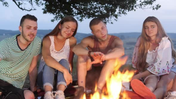 Thumbnail for Young people at the campfire