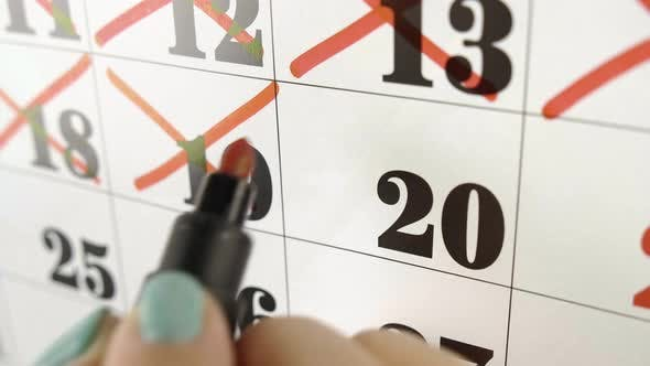 Thumbnail for Female Hand Crosses with Red Marker the Calendar Day 20. Slow Motion Shot. Close Up