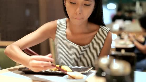 Thumbnail for Woman enjoy sushi in Japanese restaurant