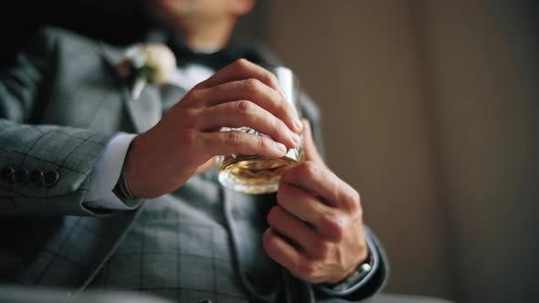 Man in Suit Drinking Whiskey From a Glass, Close Up