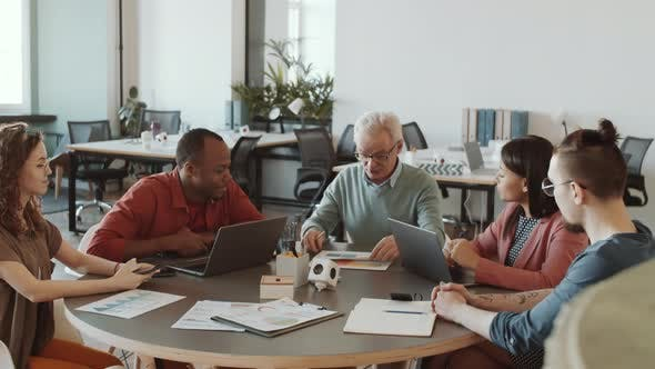 Thumbnail for Senior Boss Presenting Business Plan to Team at Office Meeting