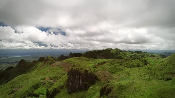 Thumbnail for Aerial view of Chocolate hills and cloudy sky in Badian, Philippines.
