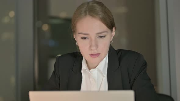 Thumbnail for Close Up of Businesswoman Working on Laptop in Office at Night