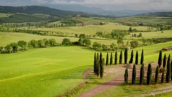 Flying over the amazing rolling hills of Tuscany Italy