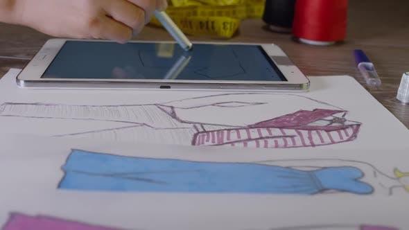 Fashion Designer Working On A Digital Tablet 12