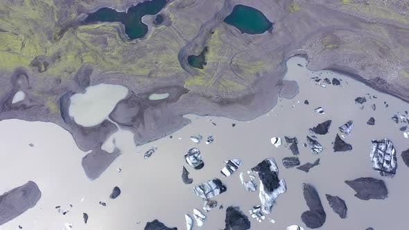 Aerial View of Floating Icebergs. Solheimajokull Melting Glacier Ice Cap, Iceland