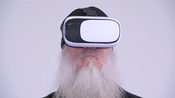 Thumbnail for Face of Mature Bearded Hipster Man Using Virtual Reality Headset