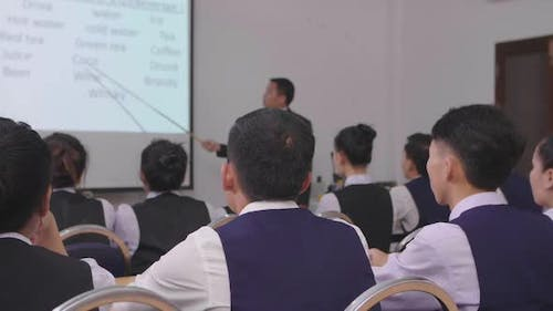 Students Listen To Professor's Lecture In Small Class Room