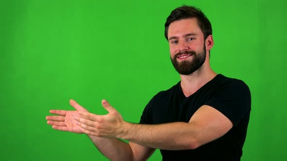 Thumbnail for Young Handsome Bearded Man Introduces Something - Green Screen - Studio