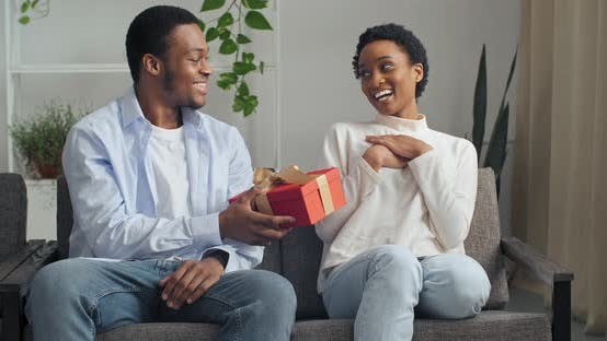 Thumbnail for Beautiful Young Afro American Couple Sitting on Couch at Home