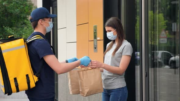 Delivery Man Wears Face Mask and Gloves to Deliver Order Masked Woman Customer