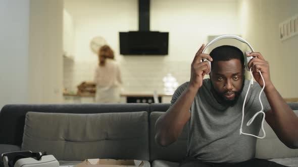 Thumbnail for Black Man Putting Headphones at Open Kitchen Smiling Guy Making Dance Movement