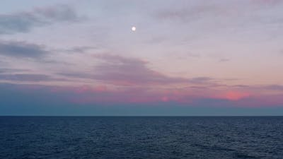 Moon with Ocean and Red Sunset Sky