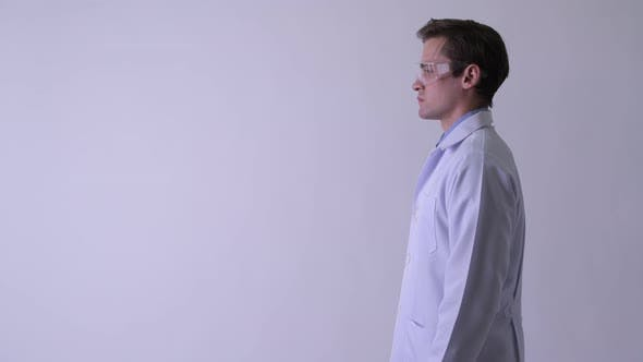 Thumbnail for Profile View of Young Handsome Man Doctor Wearing Protective Glasses