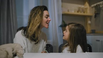 Mom Plays with Daughter in Evening