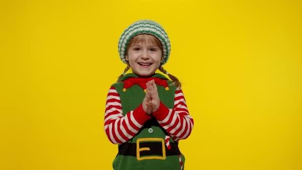 Thumbnail for Kid Girl Christmas Elf Santa Helper Steepls Fingers Waiting Gift Box