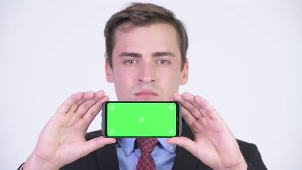 Thumbnail for Young Happy Handsome Businessman Showing Phone
