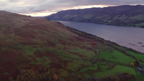 Thumbnail for Flying Over a Mountain Slope with a View of the Loch in Between Mountain Ranges