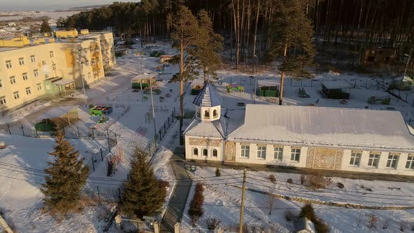Aerial view of church and kindergarten in the village