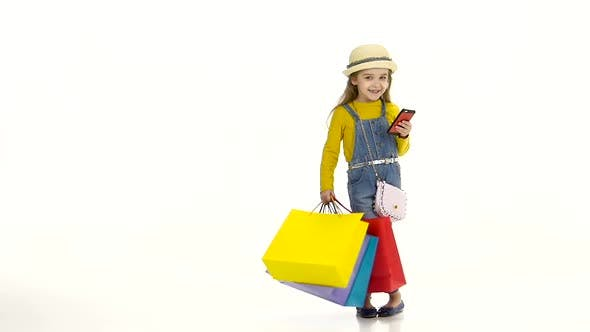 Thumbnail for Girl in a Hat with Package Holding Phone and Pishit Posts. White Background. Slow Motion
