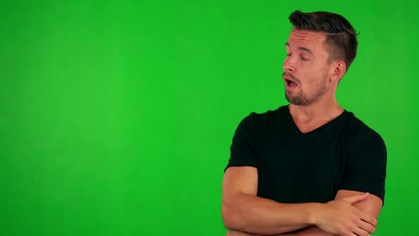 Thumbnail for Young Handsome Caucasian Man Is Bored - Green Screen - Studio
