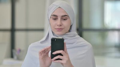 Young Arab Woman Using Smartphone