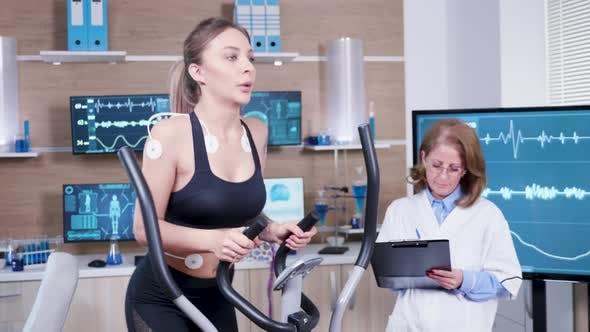 Thumbnail for Female Doctor Mesuring the Heart Activity of Female Athlete