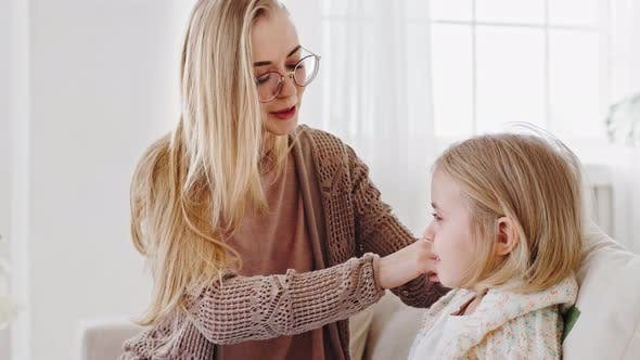 Young Caring Mother Single Mom Adult Woman Care for Child Combing Blonde Hair of Little Girl
