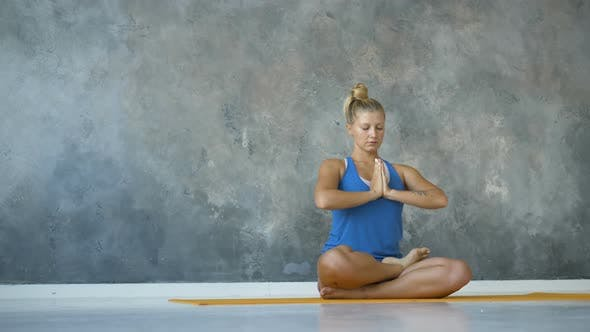 Mindfulness, Spirituality and Healthy Lifestyle Concept - Girl Meditating Relax in Lotus Namaste