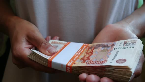Cover Image for An Unrecognizable Woman With Wad Of Russian Rubles
