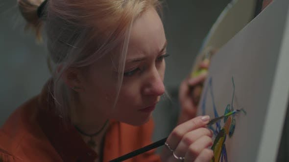 Female Painter in Creative Process in Art Studio