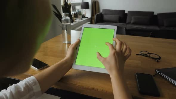 Thumbnail for Woman Using Tablet With Green Screen
