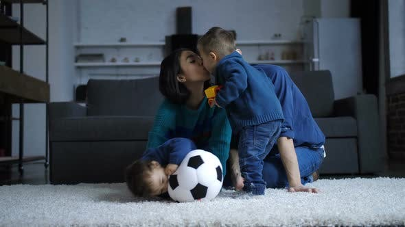 Cover Image for Toddler Son Kissing Hindu Mother at Home