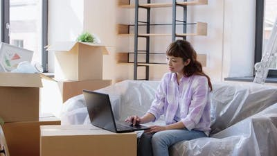 Woman with Laptop Moving Into New Home