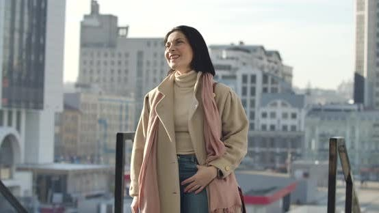 Thumbnail for Confident Brunette Caucasian Woman Standing on City Street and Looking Away. Smiling Businesswoman